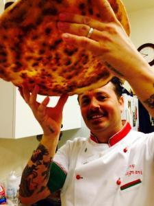 Tony Gemignani inspects a pizza